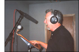 picture of Michael Knott in the recording studio. TV anouncer, narrator, director and producer. He has a deep rich voice like James Earl Jones. Known as 1-800-the-voice, 800 the voice, or just the voice